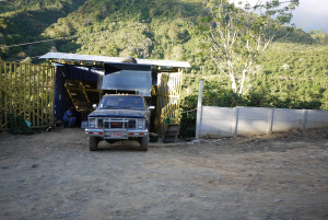 "A truck is delivering the coffee picked so far in the day in a ""recibidor"" belonging to the mill where the coffee will be brought later on to be processed, here in Tarrazu, Costa Rica."